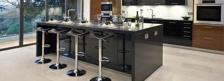 Black and Chrome Bar Stools in Modern Black Kitchen