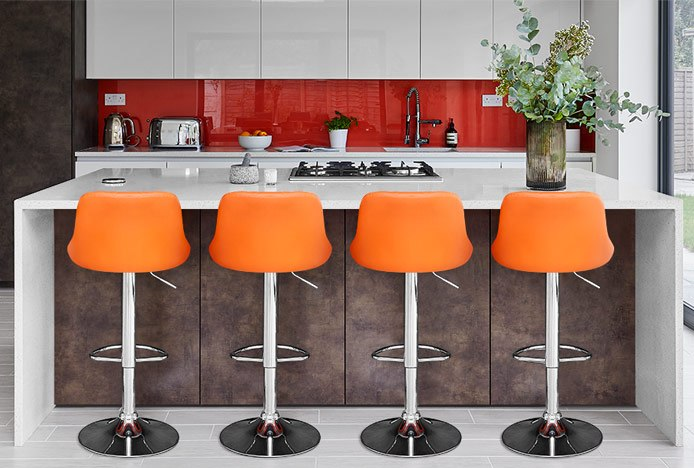Balanced Kitchen Space With Orange Stools