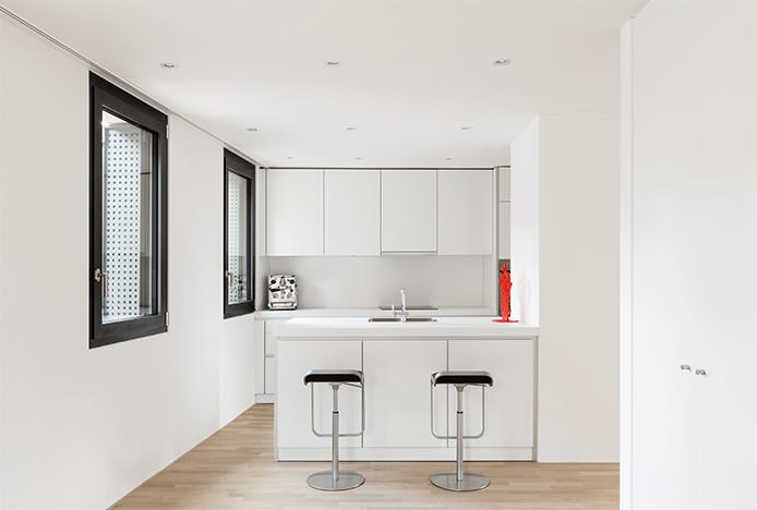 Black Art Stools in All White Kitchen