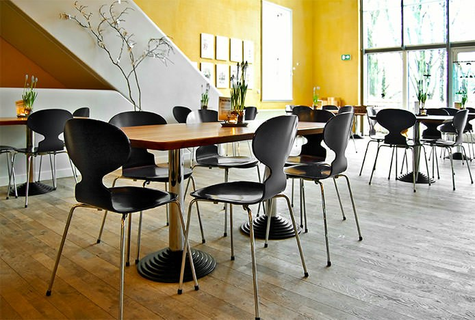 Black Stackable Bon Bon Chairs in Cafe
