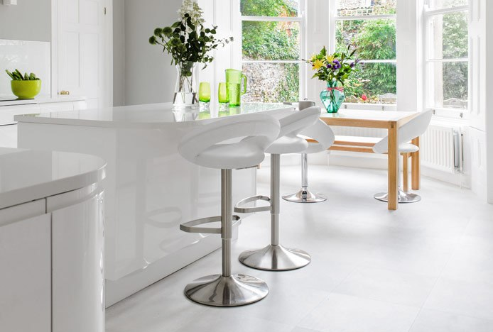 Light Bright Kitchen With Brushed Crescent Stools
