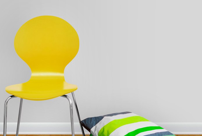 Candy Dining Chair Yellow Next To A Grey Wall