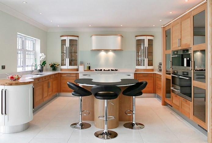 Padded Crescent Stools At Circular Kitchen Island