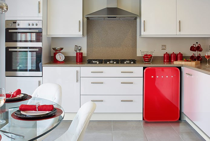 Cushioned Eames Chairs in Red and White Kitchen
