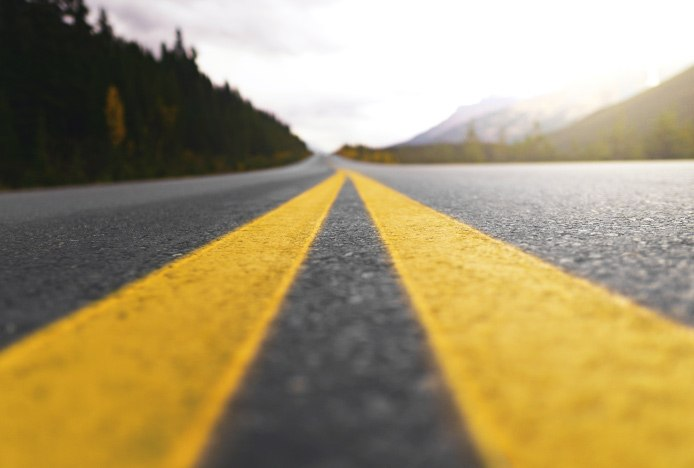 Grey And Yellow Road Ahead