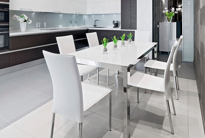 Simple Kitchen With White Dining Chairs