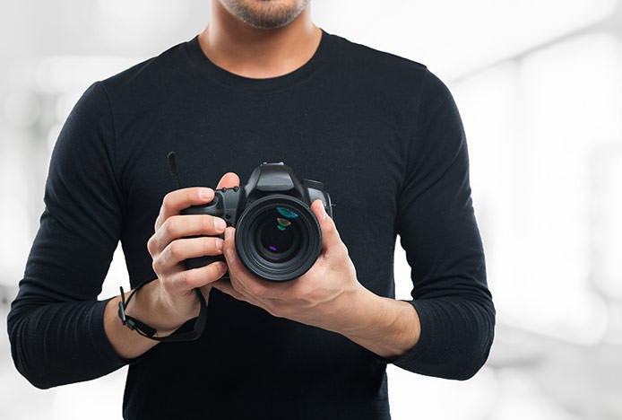 Man with DSLR Camera