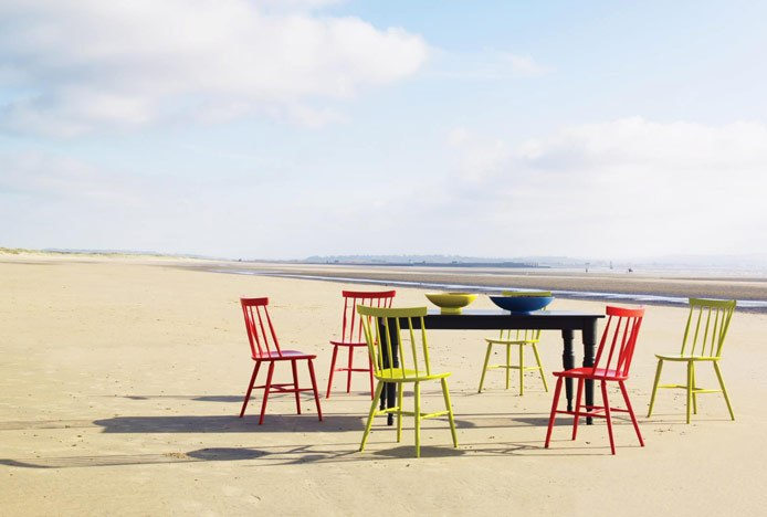 Mismatched Dining Chairs On Beach