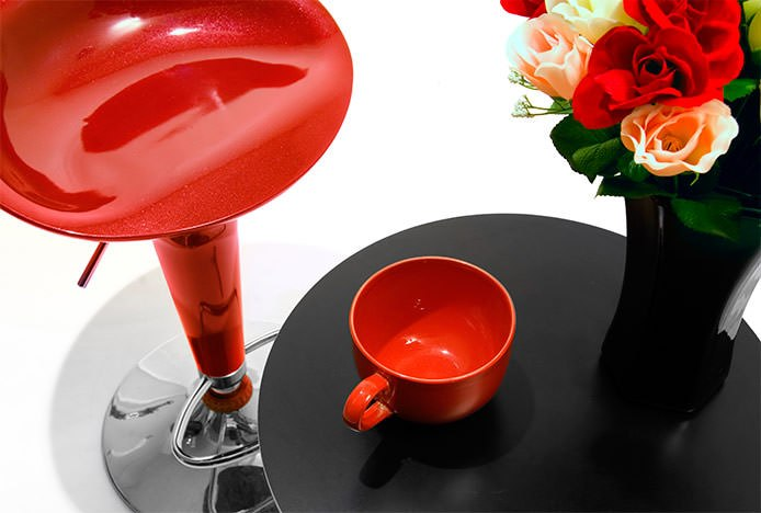 Red Bombo Stool at Black Coffee Table