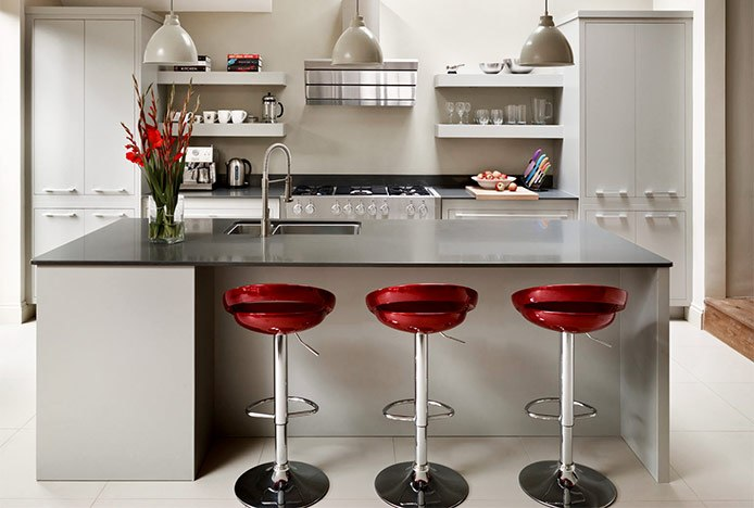 Red Crescent Stools in Cream Kitchen
