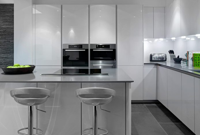 Metallic Kitchen With Crescent Bar Stools