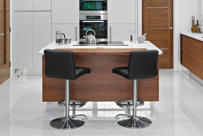 Lush Brushed Steel Bar Stools Set At An Angle