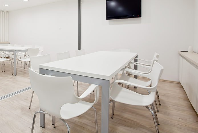 White Chairs in White Dining Room