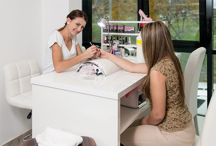 Woman on Stool in Nail Bar