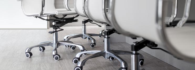 White Office Chairs on Wheeled Castor Bases