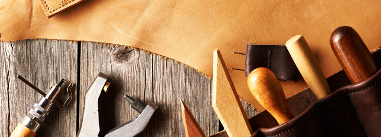 Leather Crafting Tools on Wooden Table with Brown Leather