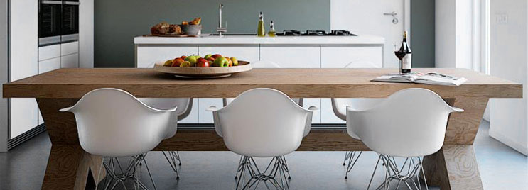 White Eames Armchairs with Metal Legs at Wooden Table